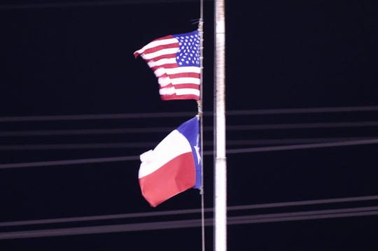 The United States and Texas state flags wave in the wind as Albany and Gruver played in the Class 2A Division II state semifinal at Sherwood Memorial Bulldog Stadium in Plainview on Thursday, Dec. 13, 2018.