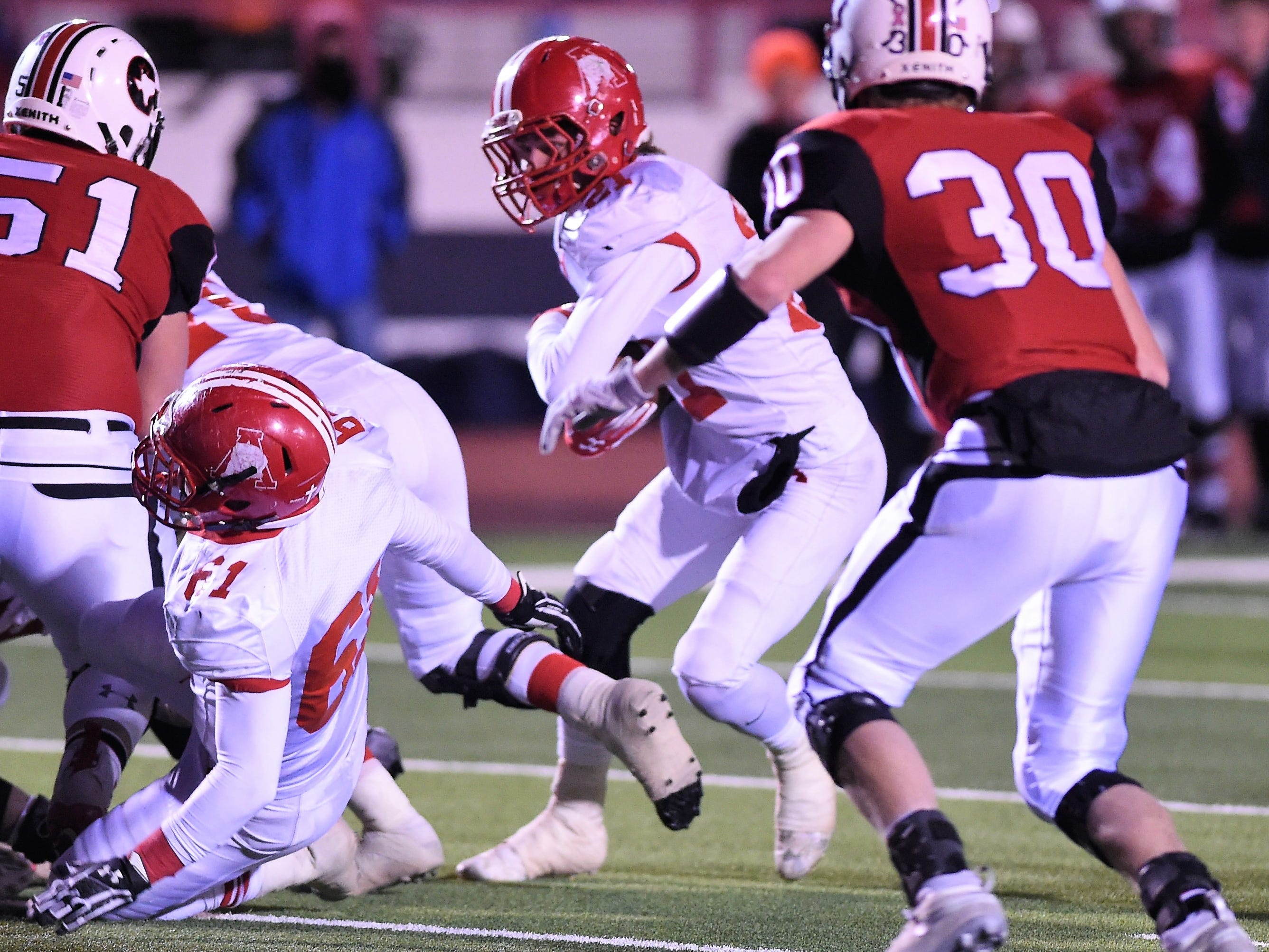 Albany's Cutter Edgar (21) tries to find a running lane against Gruver in the Class 2A Division II state semifinal at Sherwood Memorial Bulldog Stadium in Plainview on Thursday, Dec. 13, 2018.