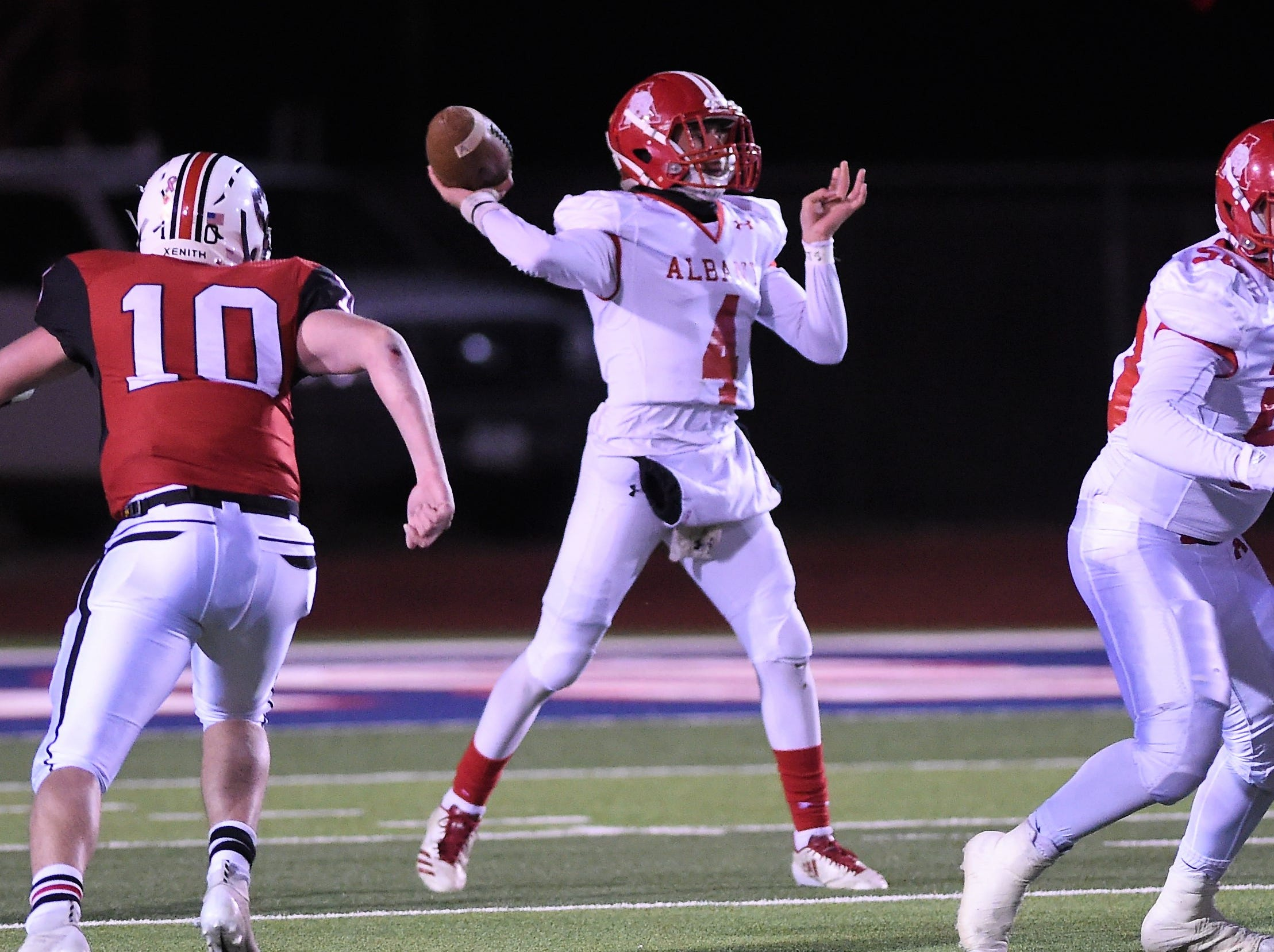 Albany quarterback Ben West (4) sets to throw a pass against Gruver in the Class 2A Division II state semifinal at Sherwood Memorial Bulldog Stadium in Plainview on Thursday, Dec. 13, 2018.