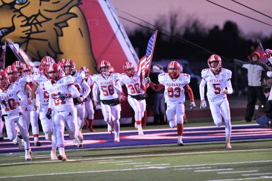 The Albany football team takes the field before facing Gruver in the Class 2A Division II state semifinal at Sherwood Memorial Bulldog Stadium in Plainview on Thursday, Dec. 13, 2018.