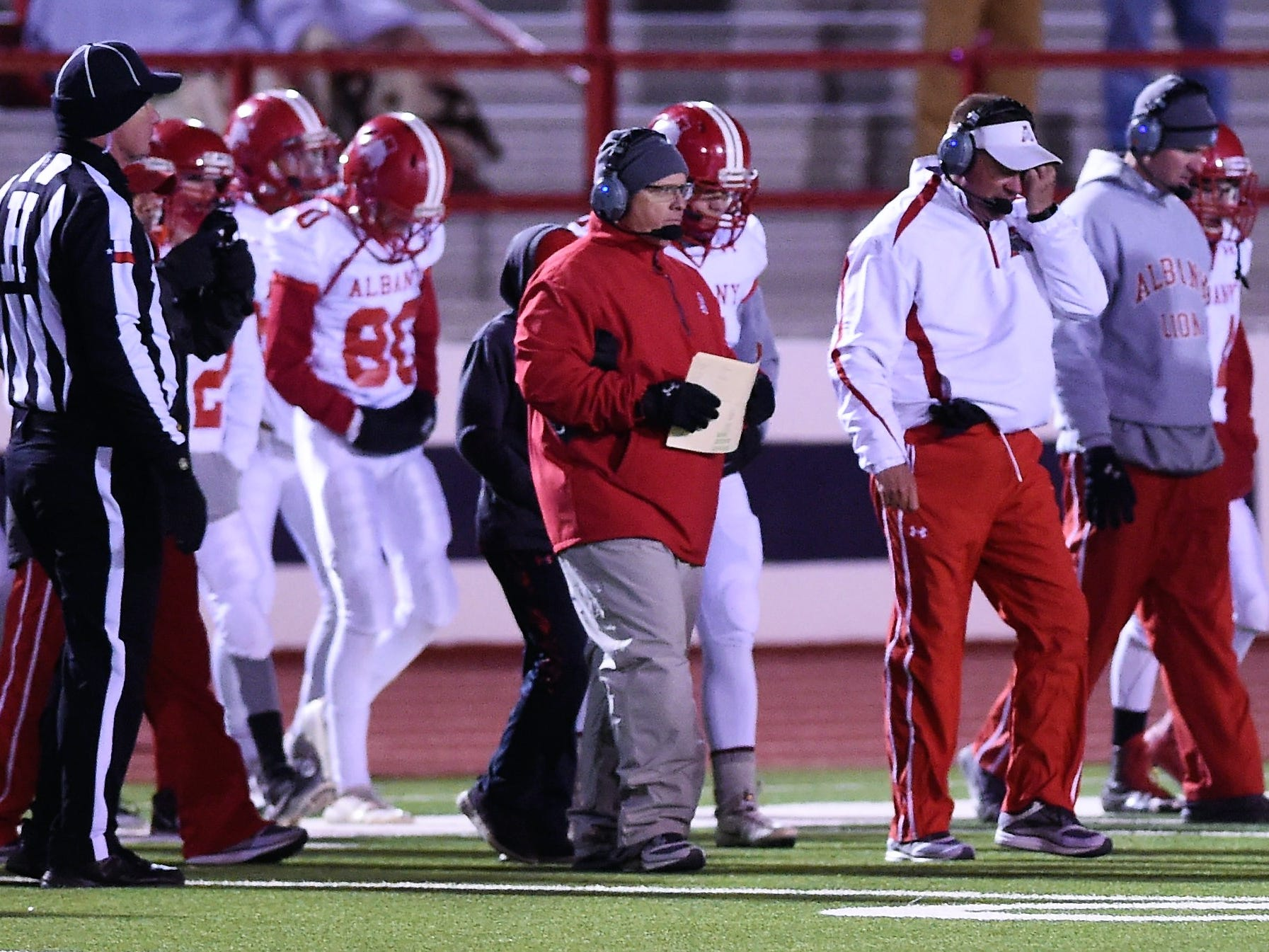Albany coach Denney Faith goes out to the field during a timeout against Gruver in the Class 2A Division II state semifinal at Sherwood Memorial Bulldog Stadium in Plainview on Thursday, Dec. 13, 2018.