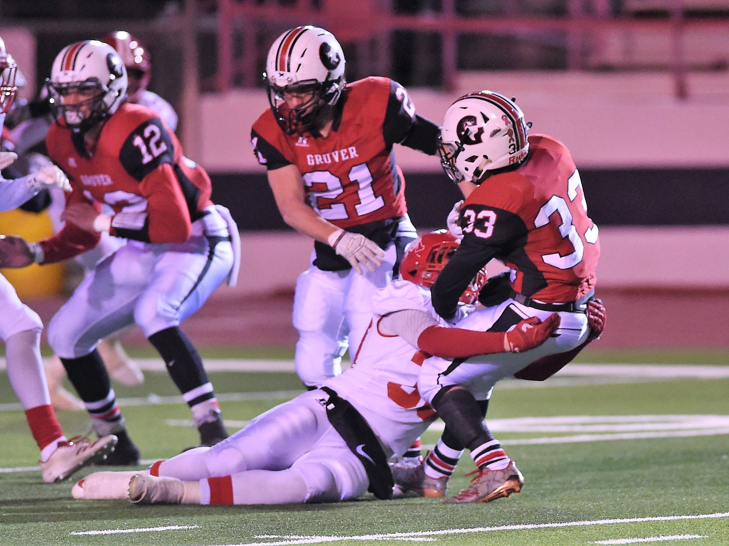Albany's Brooks Neece (30) stands up Gruver's Brice McLaughlin (33) for a loss in the Class 2A Division II state semifinal at Sherwood Memorial Bulldog Stadium in Plainview on Thursday, Dec. 13, 2018.