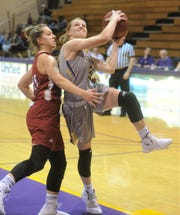 Hardin-Simmon's Samantha Newton, right, drives to the basket against an Austin College defender.