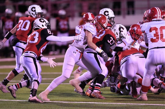 Albany's Ryan Hill (20) wraps up Gunter's Brice McLaughlin (33) in the Class 2A Division II state semifinal at Sherwood Memorial Bulldog Stadium in Plainview on Thursday, Dec. 13, 2018.