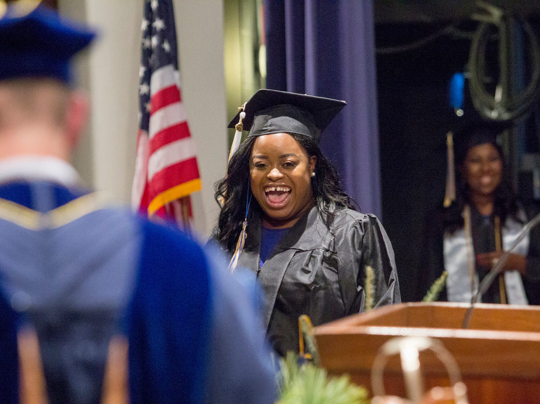 Jakayla Morrison receives her diploma from President Tony Floyd. Mars Hill University conferred bachelor's degrees on 71 graduates on Dec. 14, 2018.