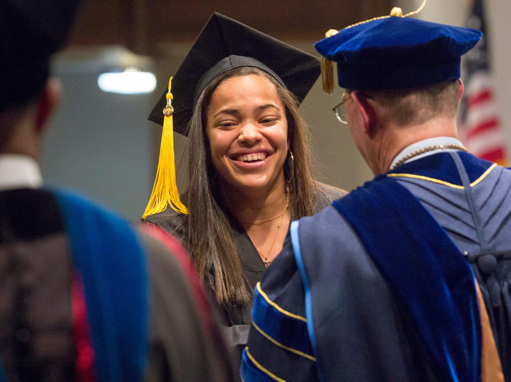 Moriah Johnson receives her diploma from President Tony Floyd. Mars Hill University conferred bachelor's degrees on 71 graduates on Dec. 14, 2018.
