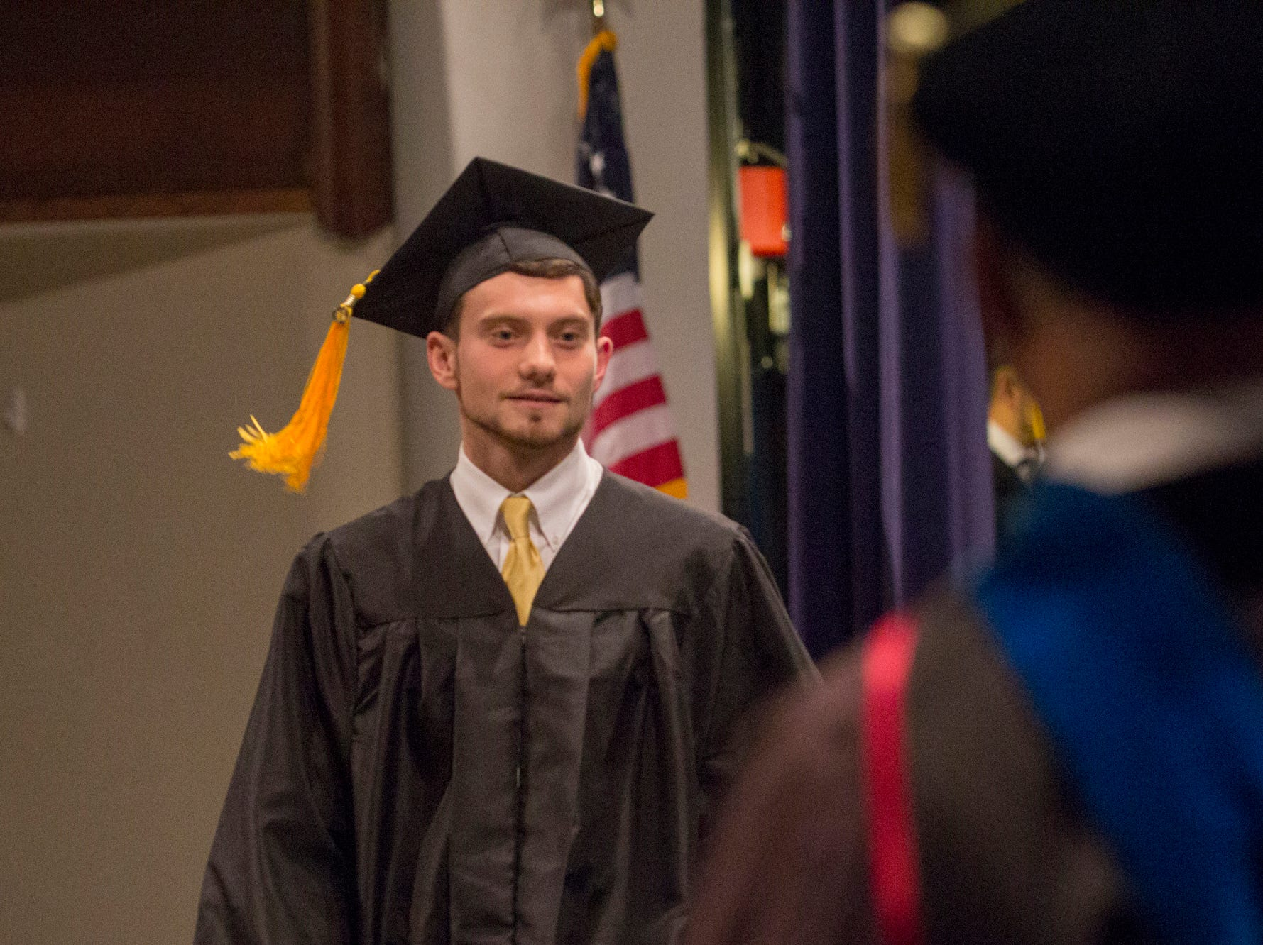 Garrett Farrimond walks across the stage at Mars Hill University graduation. Mars Hill University conferred bachelor's degrees on 71 graduates on Dec. 14, 2018.