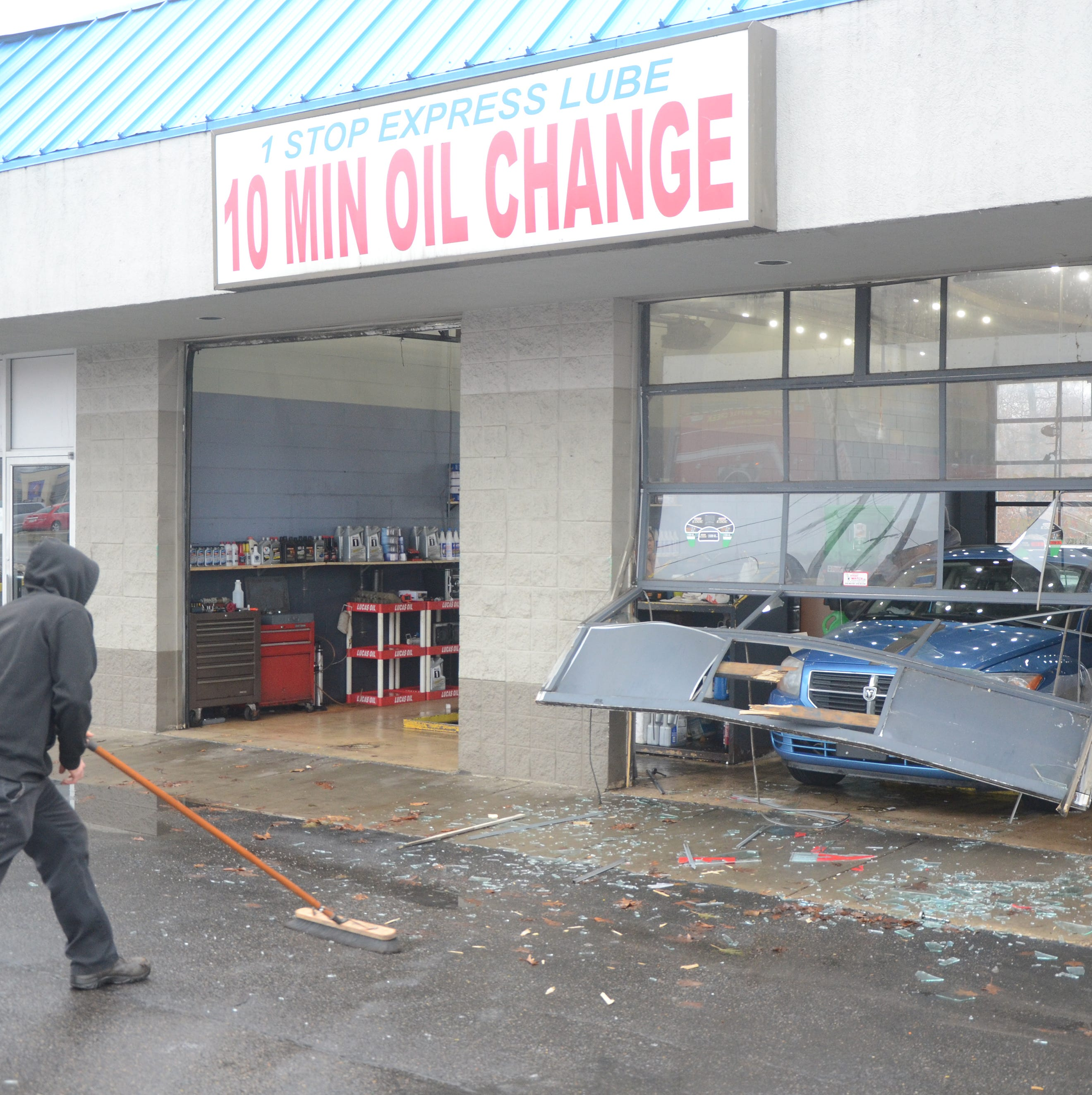 Police & Fire: Man injured after being hit by vehicle inside oil change business