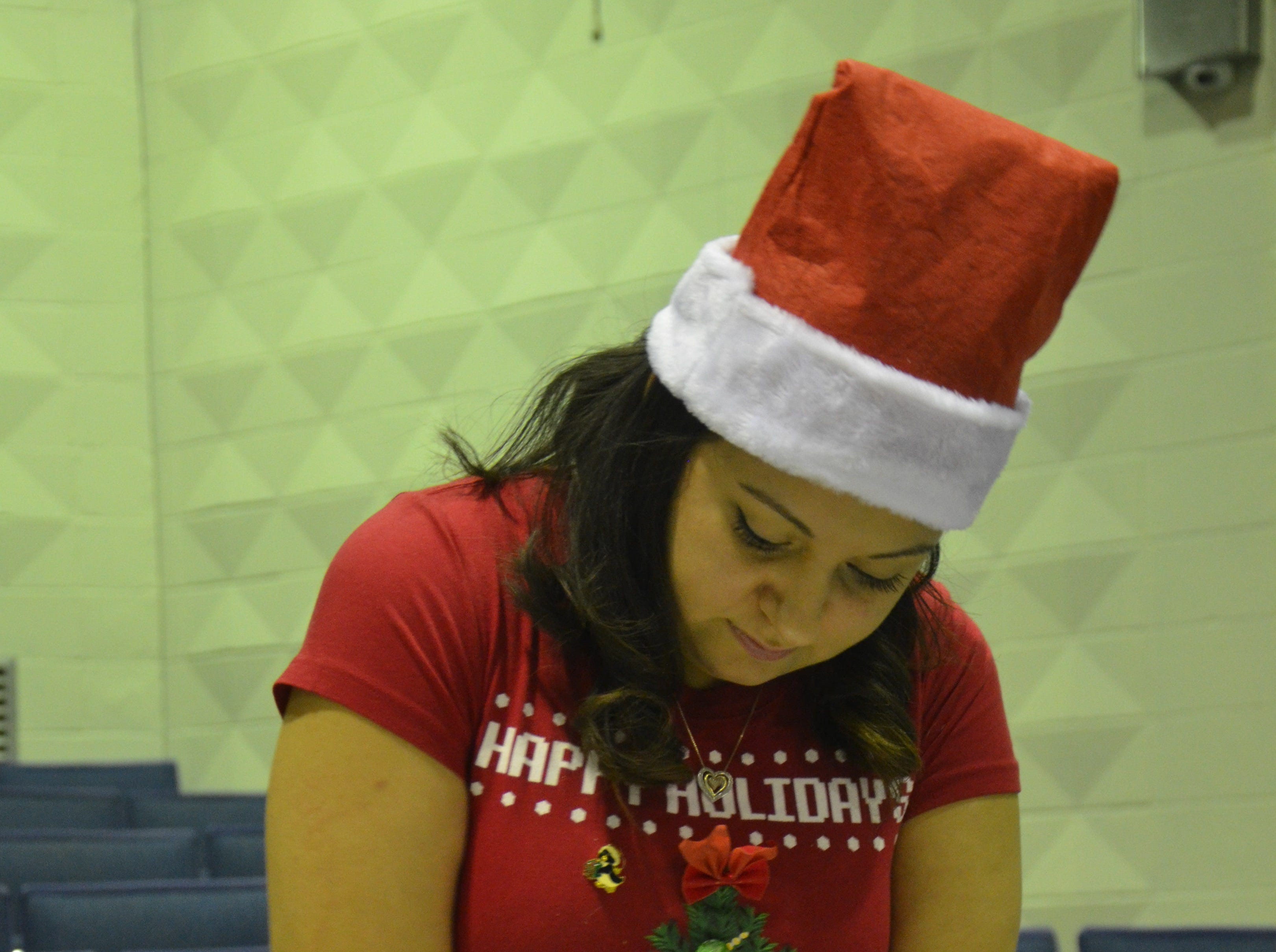 April Ortiz helped out to wrap presents on Friday. She is engaged to Danny Irons.