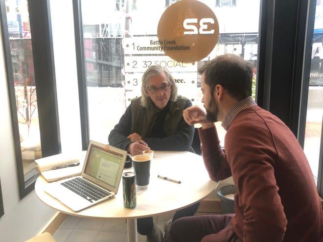SecondMuse Associate Tony Salvadore (left) talks with Battle Creek community member Tom Ryberg.