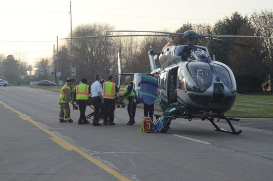 Moran Jungen is taken to a medical helicopter after the crash Thursday, Dec. 13, 2018 on Dickman Road.