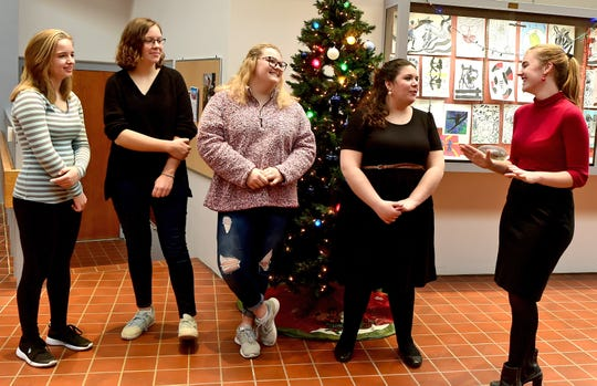 Members of Owego Free Academy's Interact Club talk about fundraising and organizing the school's Winter Gala. The Interact Club is raising money to buy books for Thai orphans.  December 14, 2018.