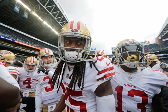 San Francisco 49ers cornerback Richard Sherman huddles with teammates before a Dec. 2 game against the Seahawks in Seattle. The rematch between the Seahawks and 49ers is on Sunday.