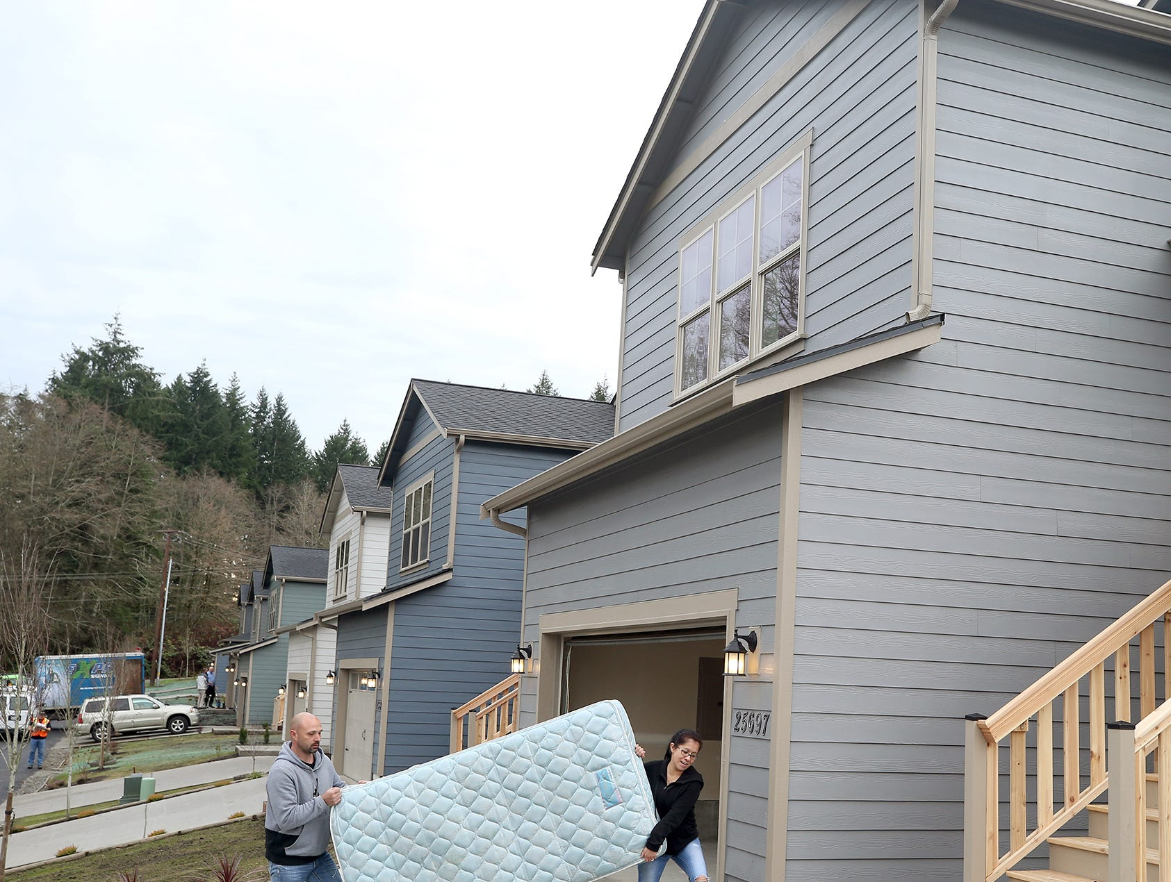 Daniel and Sara Grannell move in to their new home after the opening ceremony of the Maple Lane Group One Kitsap Housing development in Kington on Friday, December 14, 2018.