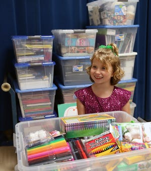 Olalla Elementary student Gloria Bass, 8, shows art supplies that she helped collect for children at Mary Bridge Children's Hospital. The art supply drive was Gloria's idea, and her second-grade teacher helped her lead a community-wide art supply drive.