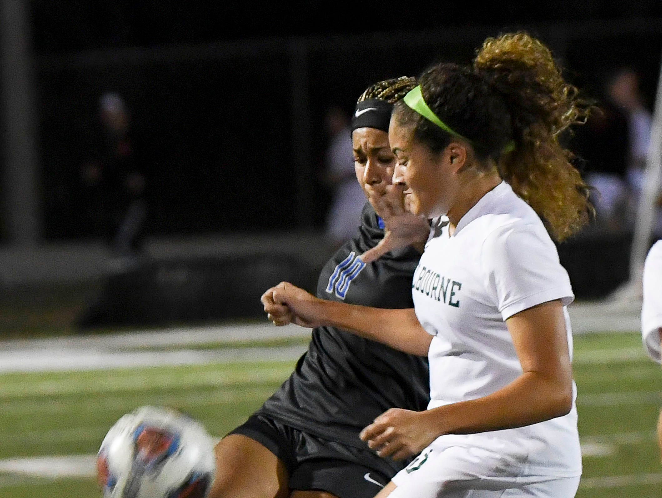 Maya Gordon of Cypress Bay directs the ball away from Melbourne's Natalie Horde during Thursday's game in Melbourne