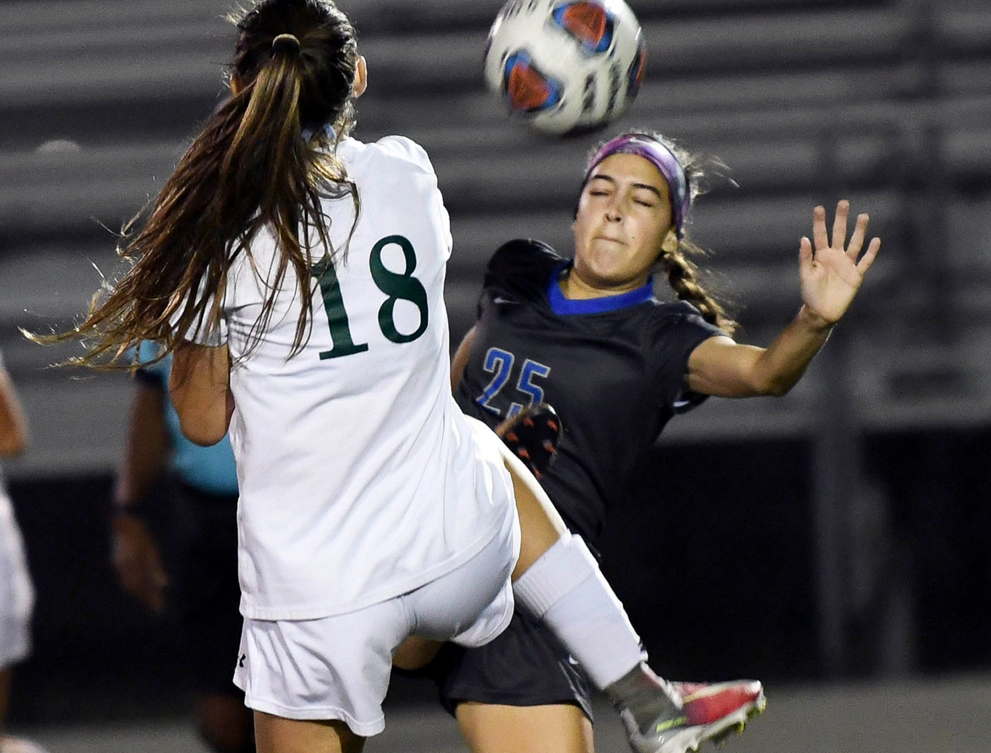 Melbourne's Jordan Smith (18) and Sabrina Hernandez of Cypress Bay battle for control of the ball during Thursday's game in Melbourne.
