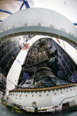 The U.S. Air Force's first Lockheed Martin-built GPS III satellite was encapsulated inside the payload fairing of a SpaceX Falcon 9 rocket before launch from Cape Canaveral Air Force Station.