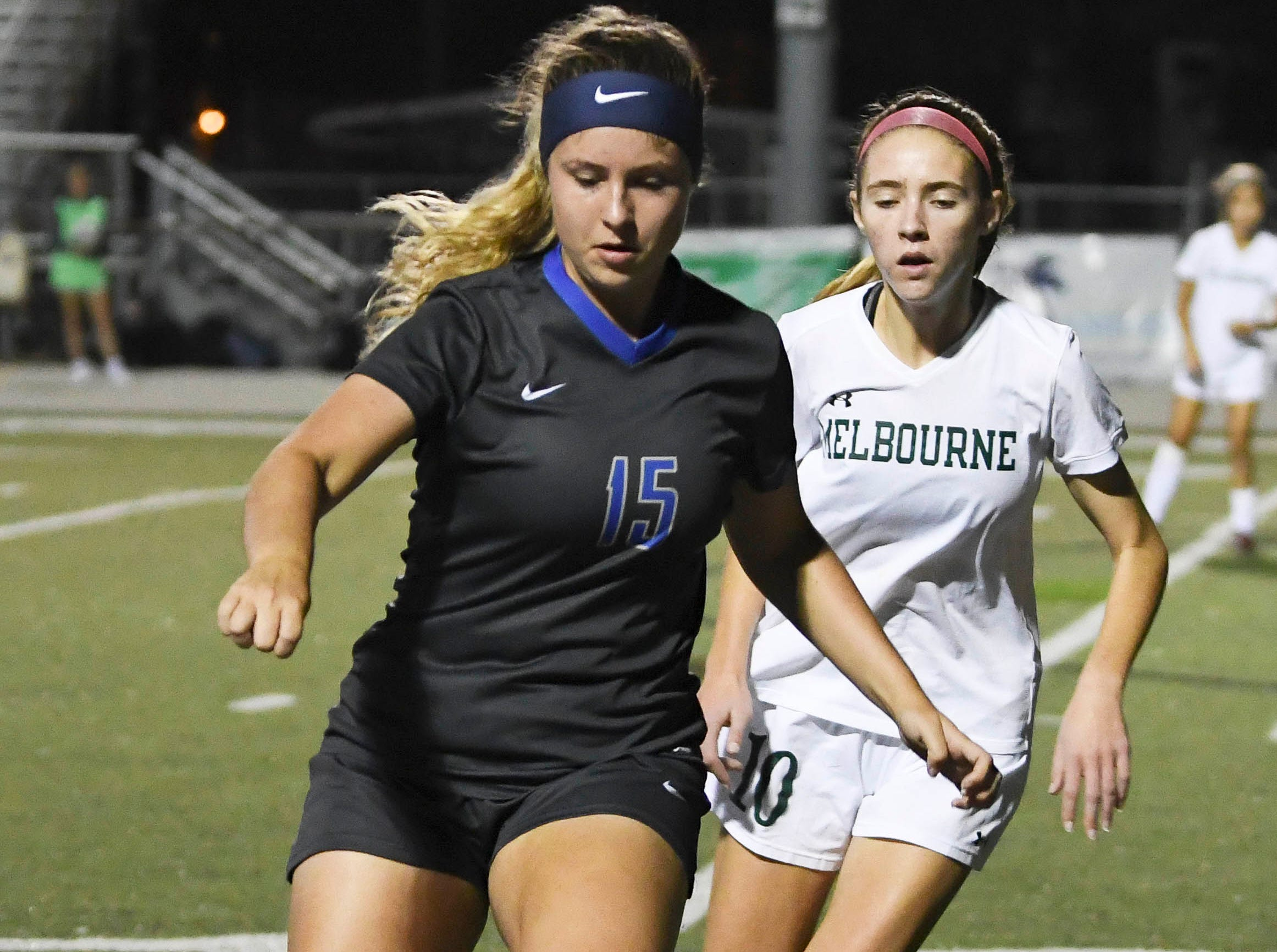 Sonya Carmona of Cypress Bay controls the ball in front of Melbourne defender Carter Register during Thursday's game.