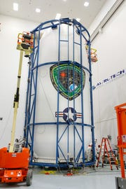 The U.S. Air Force's first Lockheed Martin-built GPS III satellite was encapsulated in the fairing of a SpaceX Falcon 9 rocket before launch from Cape Canaveral Air Force Station.