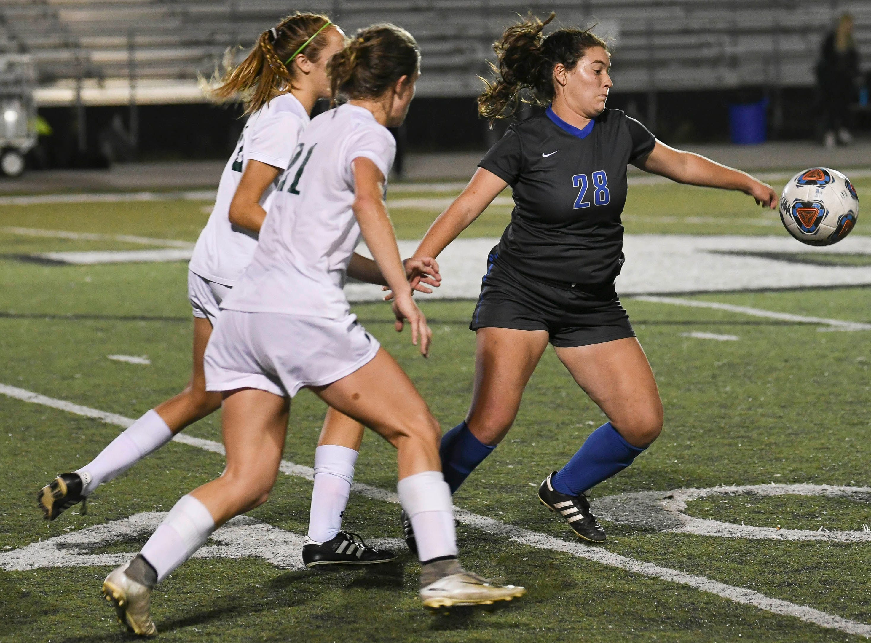 Samantha Rheingold of Cypress Bay controls the ball in front of a pair of Melbourne defenders during Thursday's game in Melbourne.