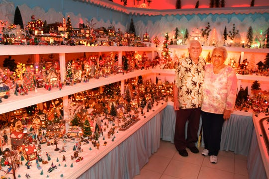 """Bill and Sadie Peters in the """"Christmas City"""" room of their home. This will become Bill's office after they dismantle the miniature city."""
