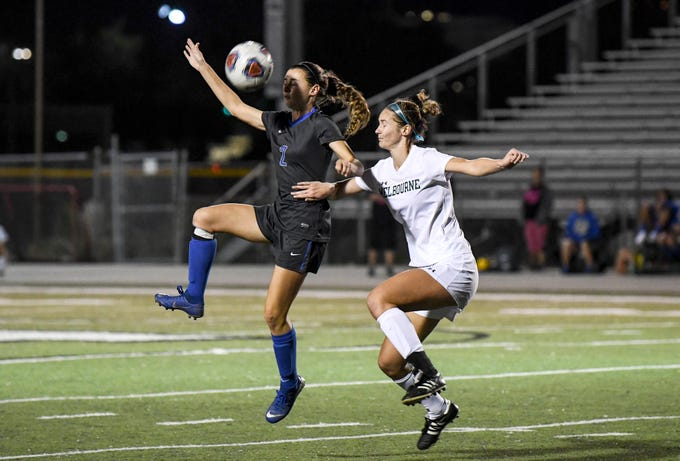 Megan Morgan of Cypress Bay heads the ball away from Kimberly Ciarcia of Melbourne during Thursday's game.