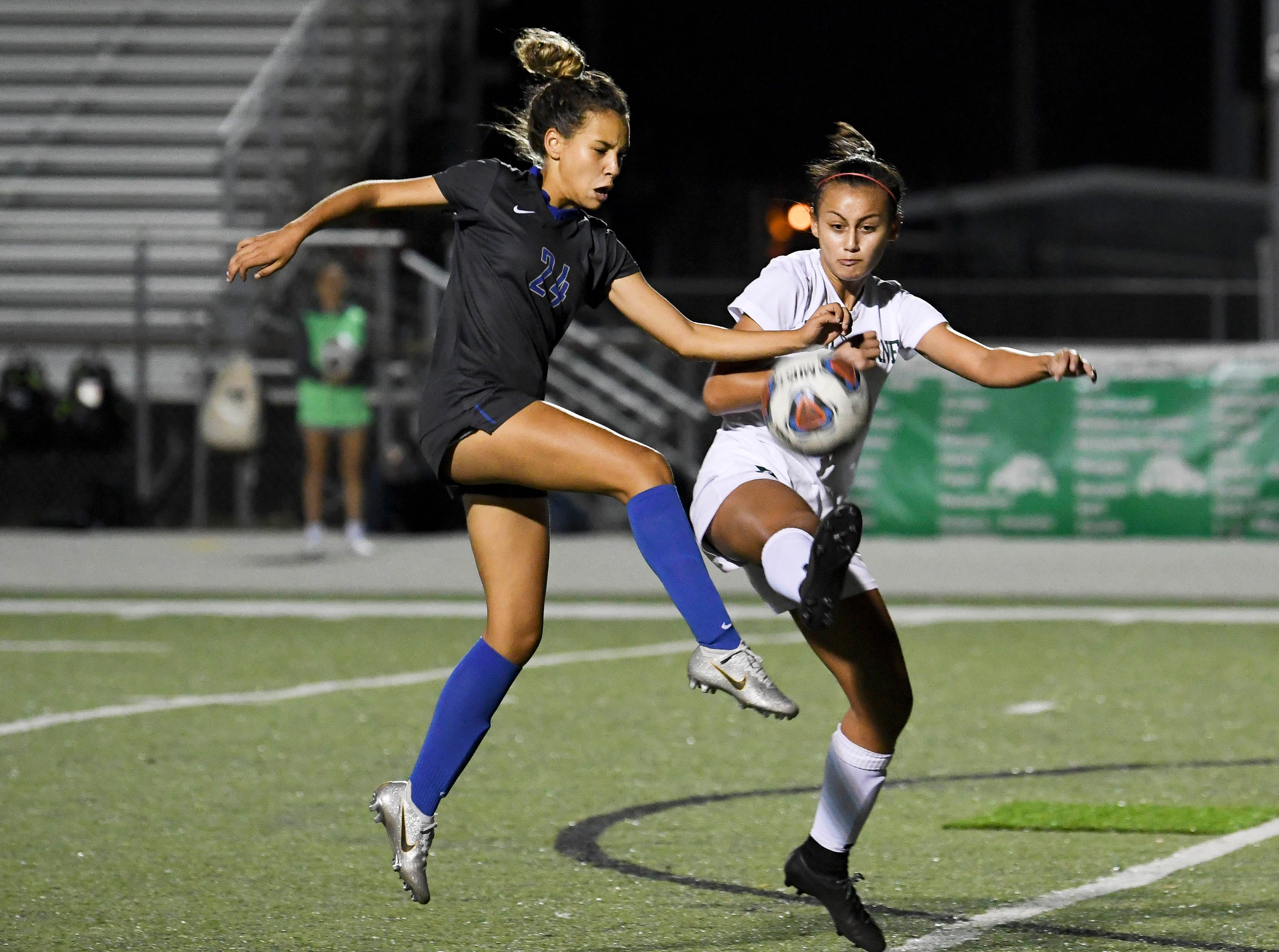 Fabiola Melendez of Cypress Bay and Allysyn Brust of Melbourne battle for control of the ball during Thursday's game in Melbourne