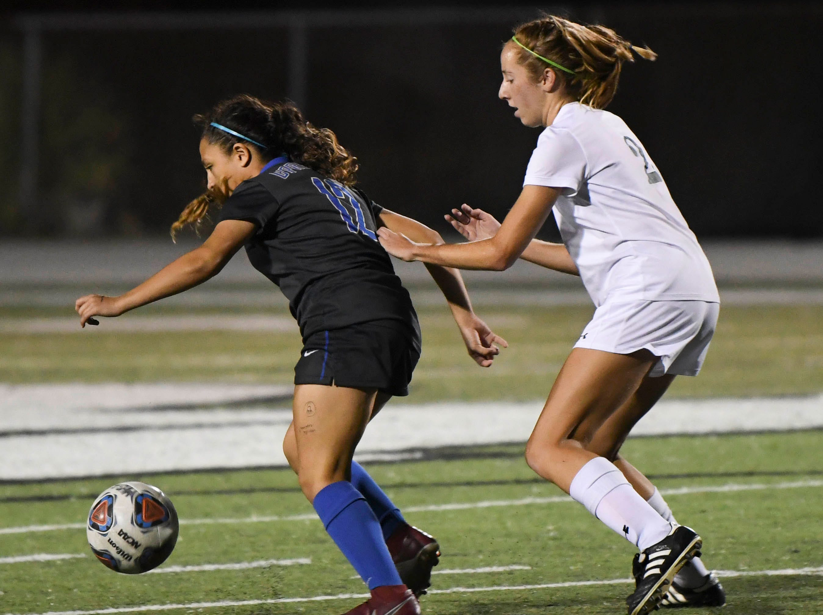 Melbourne's Lindsay Baldwin chases Barbara Garcia of Cypress Bay during Thursday's game in Melbourne.