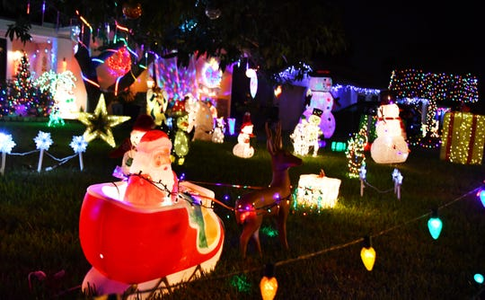 Illuminated stars, gifts, snowmen, penguins, trains, bells, Christmas trees, snowflakes, icicles, reindeer, angels and a nativity scene pack the Peters' front yard, among additional Yuletide displays.
