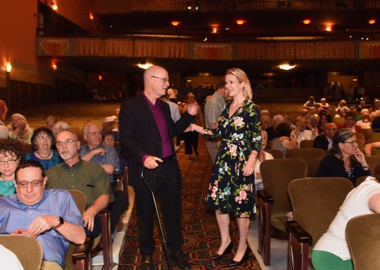 Outgoing Executive Director John Killacky embraces his successor. Anna Marie Gewirtz, at the Everybody Belongs: A Celebration Honoring John Killacky at the Flynn Center for the Performing Arts in Burlington on Tuesday, June 26, 2018.