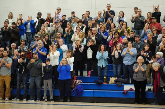 Fans cheer for the late coach Peter Quinn who died suddenly last week during the boys basketball game between the BFA Fairfax Bullets and the Vergennes Commodores at Vergennes Union High School on Thursday night December 13, 2018 in Vergennes.