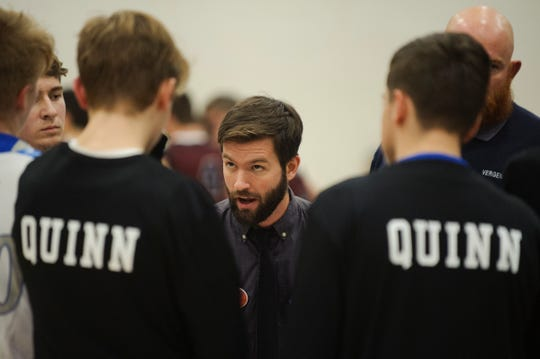 Vergennes head coach Joshua Carter talks to the team during a time out during the boys basketball game between the BFA Fairfax Bullets and the Vergennes Commodores at Vergennes Union High School on Thursday night December 13, 2018 in Vergennes.