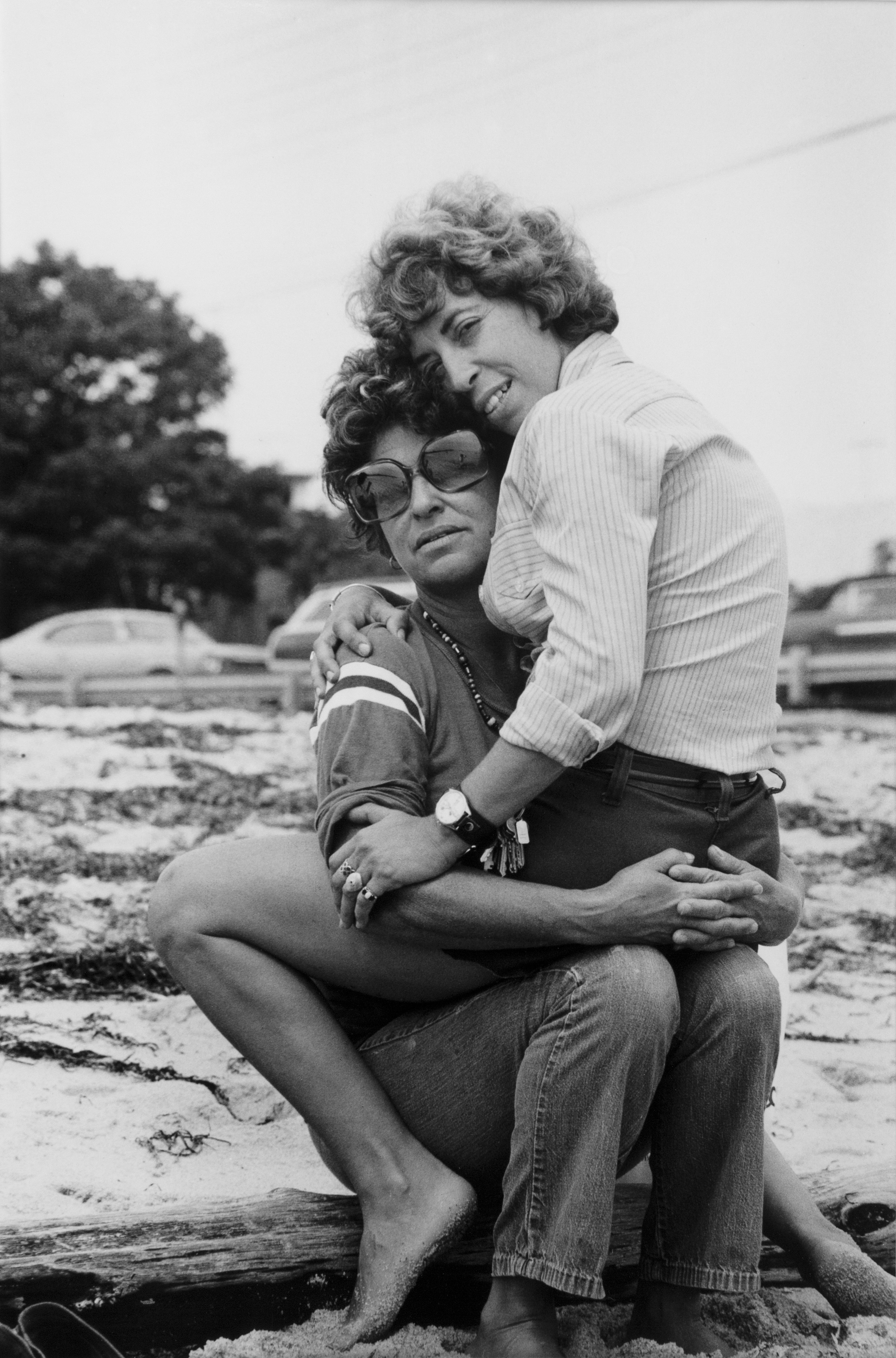 """""""Helaine on her girlfriend's lap, Provincetown,"""" 1974, is on view as part of the photography  exhibition """"Donna Gottschalk: Brave, Beautiful Outlaws,"""" on view at the Leslie-Lohman Museum until March 17, 2019."""