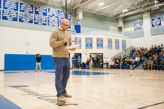 Ben Epstein reads a statement from Peter Quinn's family  during the boys basketball game between the BFA Fairfax Bullets and the Vergennes Commodores at Vergennes Union High School on Thursday night December 13, 2018 in Vergennes.