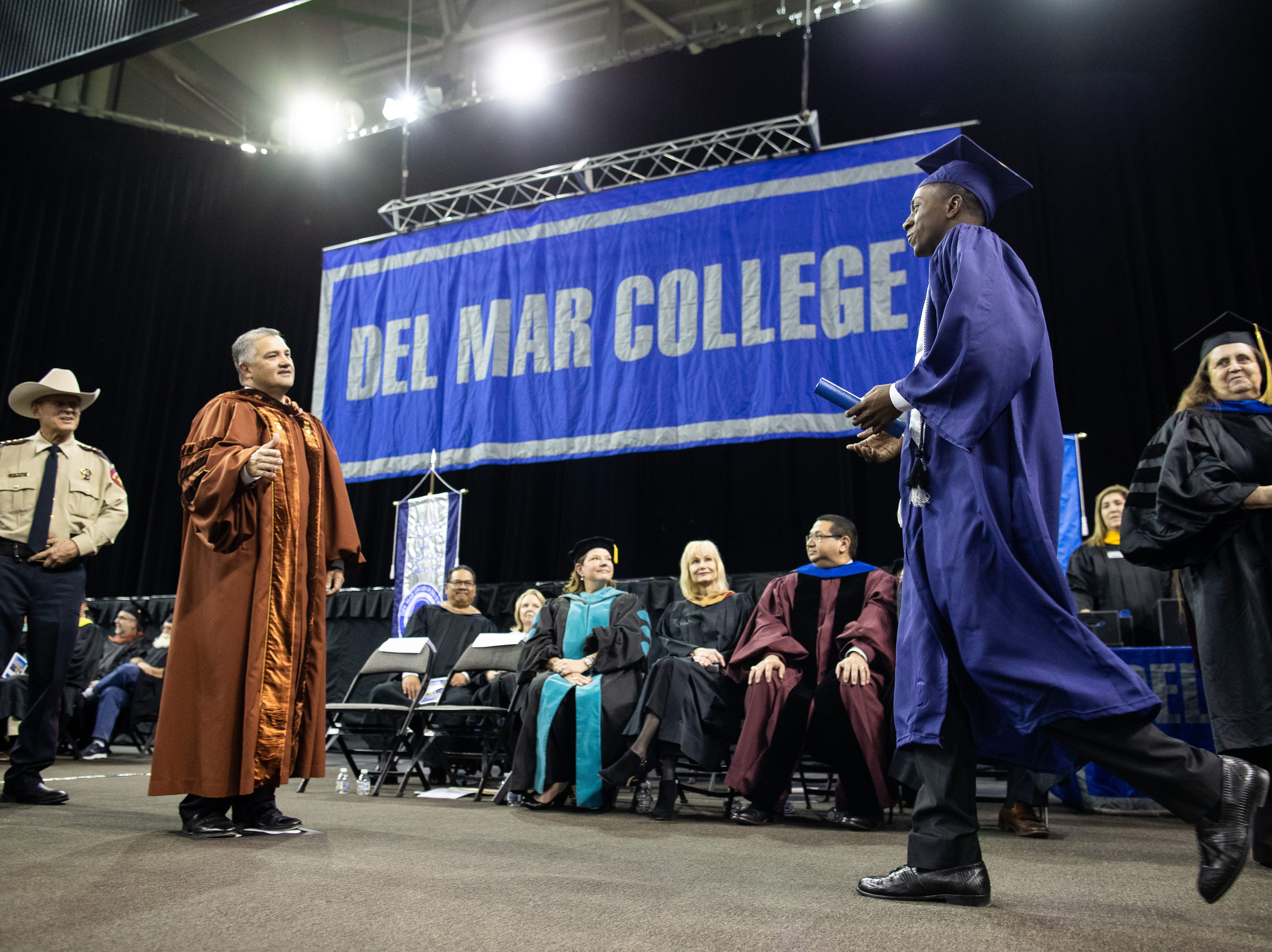Flour Bluff's High School's Jeremiah Baldwin is giving his associateÕs degree in liberal arts during the of Del Mar's fall commencement ceremony on Thursday, Dec. 13, 2018.