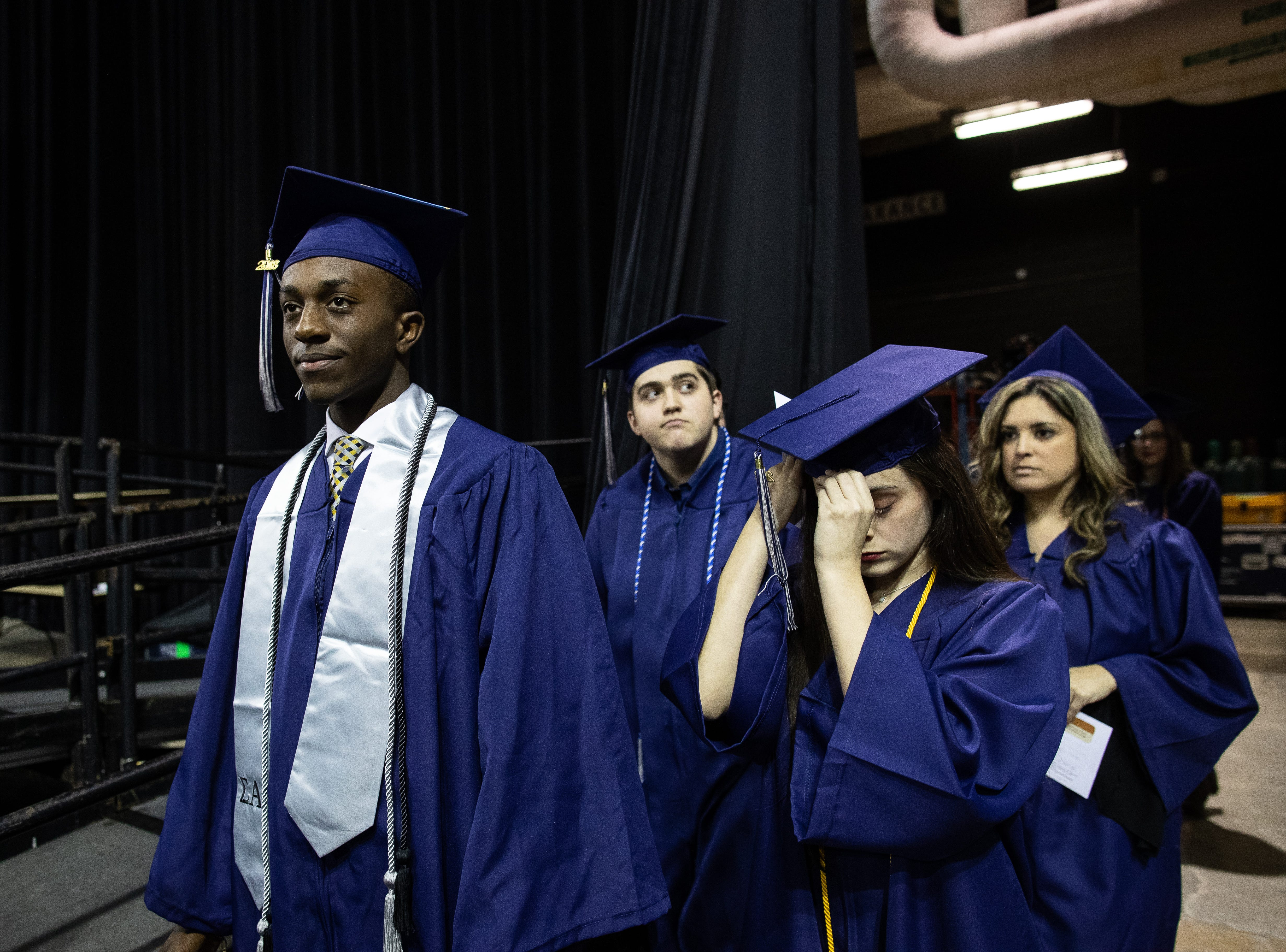 Flour Bluff's High School's Jeremiah Baldwin's and Robstown High School 's AJ Barrera during the  of Del Mar's fall commencement ceremony on Thursday, Dec. 13, 2018.