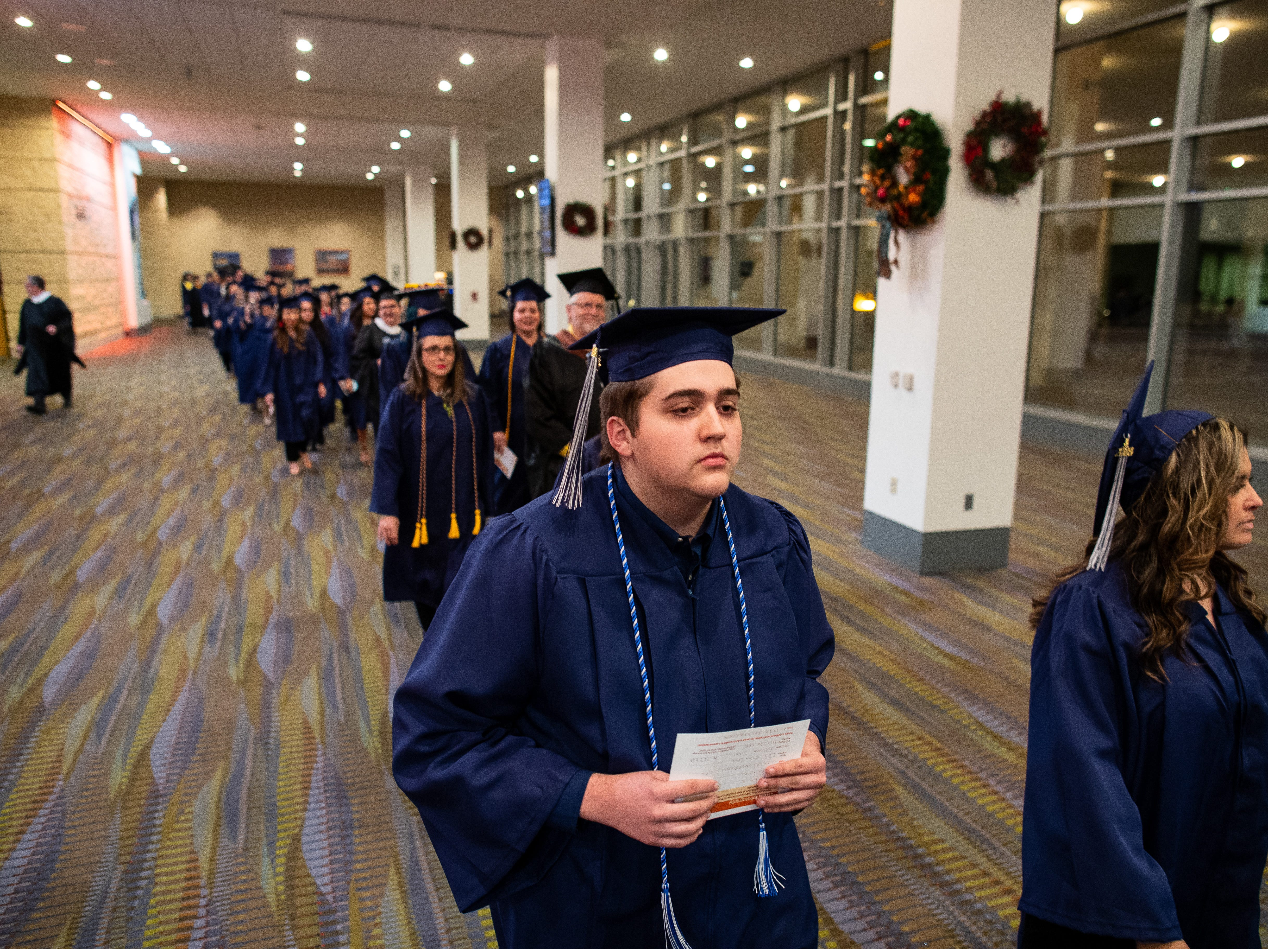 Robstown High School 's AJ Barrera waits for the start of Del Mar's fall commencement ceremony on Thursday, Dec. 13, 2018. AJ Barrera is the first senior in Robstown ISD's history to get an associate's degree before officially getting his high school certificate