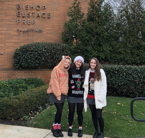 Bishop Eustace seniors Hannak Steacker (from left), Savannah Pobre and Maeghan Biche join in Ugly Sweater Day at the Pennsauken parochial school  on Dec. 14. Earlier in the season, the teens were among 13 students who filmed a video lip-syncing to Mariah Carey's 'All I Want for Christmas.'