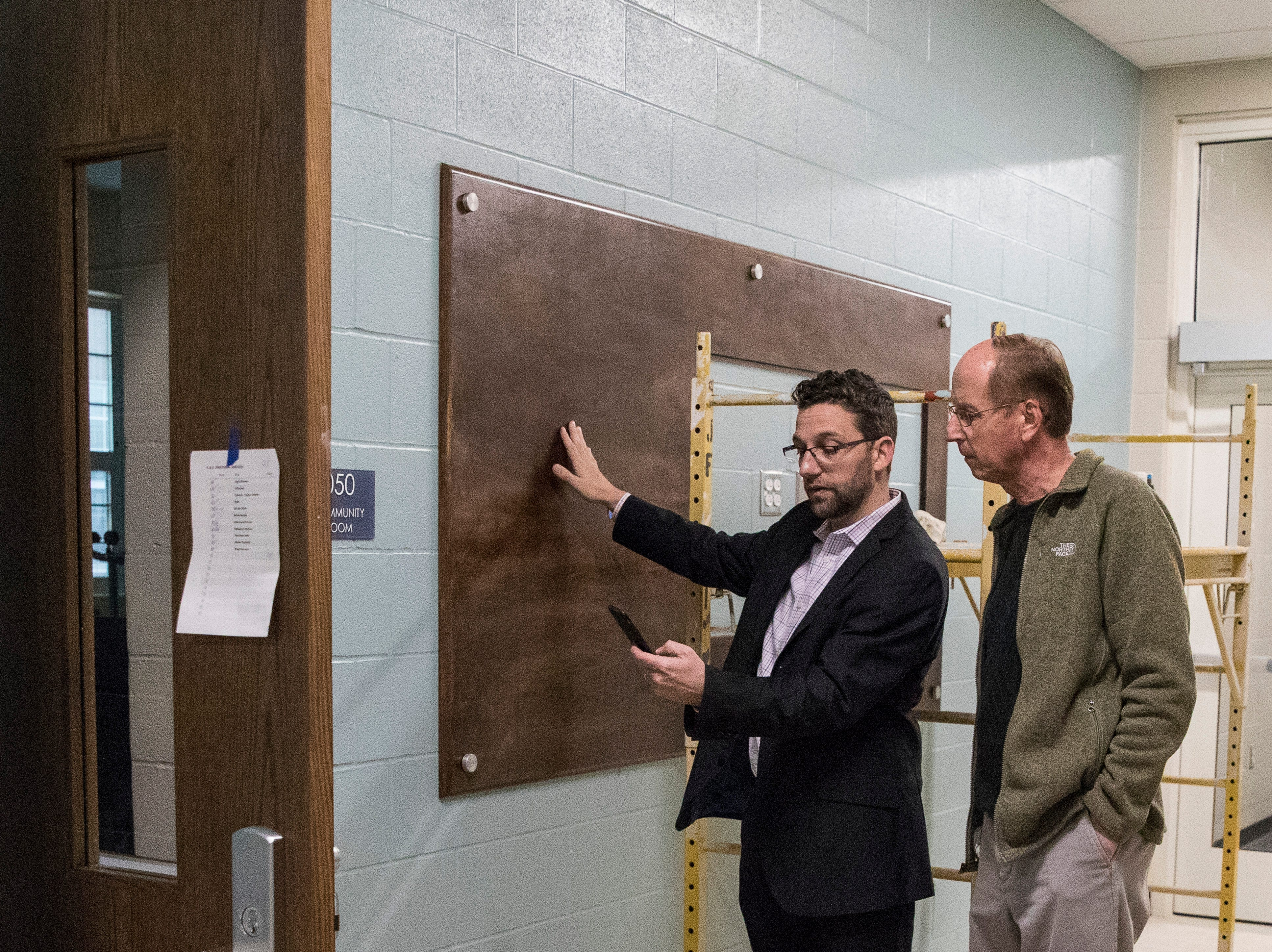 Architect Charlie Jahnigen, left, describes how historical figures like Tecumseh will be presented to both educate and decorate the new Chillicothe Intermediate  School and preserve the community's historical significance.