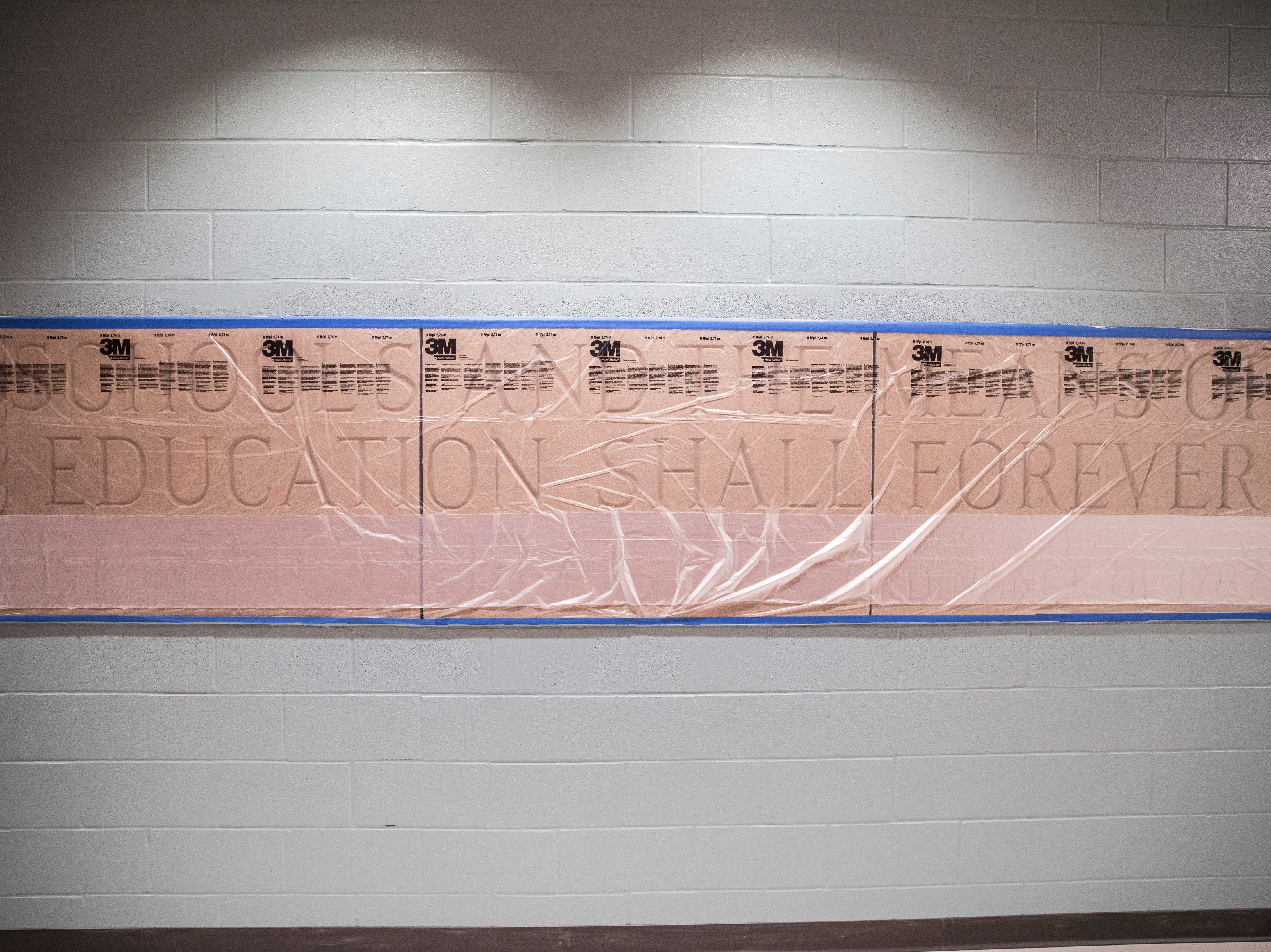 A plaque from Tiffin Elementary is embedded in the wall of the new Chillicothe Intermediate School to help preserve the history of the area.