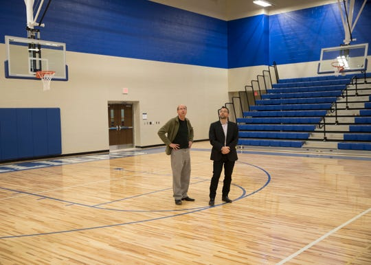 School board president Steve Mullins and architect Charlie Jahnigen show off the new gym/basketball court at Chillicothe Intermediate School.