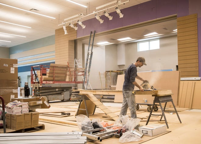 A construction worker cuts wood as completion of the new lunch room and stage area in the new Chillicothe Intermediate  School gets ready to be presented to the community in January.