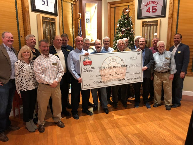 Character and Courage Foundation team members present a $10,000 grant to Joe Nuxhall Miracle League at Green Diamond Gallery on Thursday night.