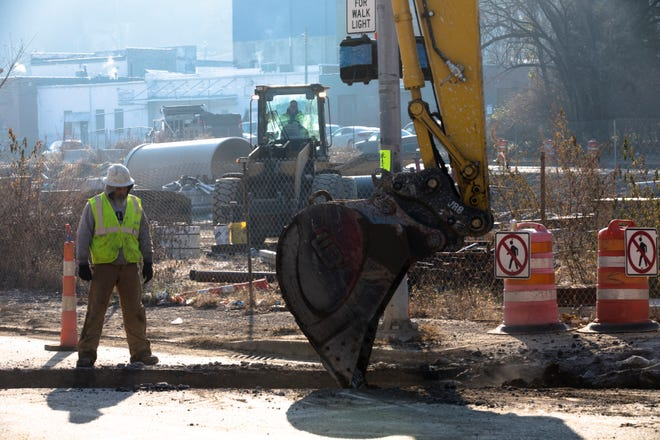 Construction workers dig up part of Queen City Avenue, Monday, Dec. 10, 2018, in South Fairmount. The $90 million project will install a sewer line underneath a new park and green space. The project started in 2017 and will take until 2020 to complete.