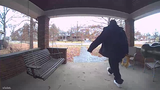 Homeowner video of a man taking packages off a College Hill porch.