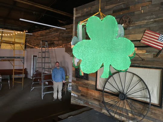 Wes Mitchum of the Houston County Fair Board, tests lowering the star of Erin's first Shamrock Drop. He plans to add more lights, which will be remote-controlled to illuminate at the stroke of midnight.