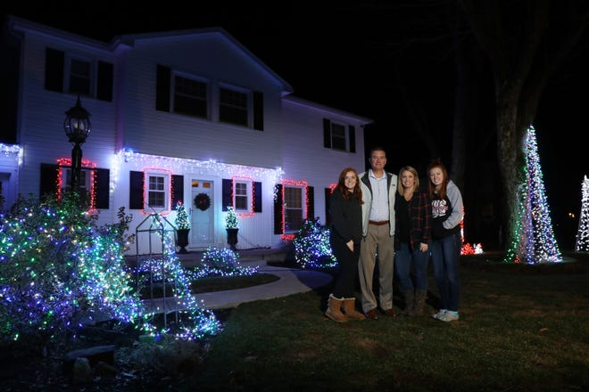 The Miller Family, Grace, Matt, Valerie and Maddy, have a musical light display at their home at 2050 Buena Vista Dr in Coshocton.