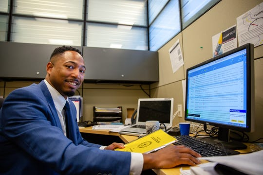 Kameron Middlebrooks, minority business coordinator at Iowa State University Extension and Outreach, at his office in the Evelyn K. Davis Center in Des Moines.