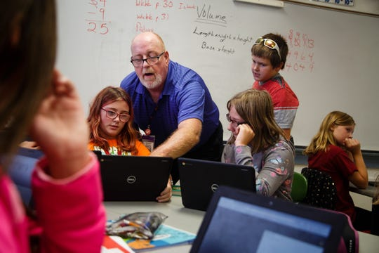 Math and Technology teacher Jeff Whylie shows a class of fifth graders how to create basic code on Wednesday, Oct. 3, 2018 in Jefferson. Whylie came out of retirement to create the curriculum which will open the doors for students to get high paying tech jobs like the ones software consulting company, Pillar Technology plans to bring to downtown Jefferson.